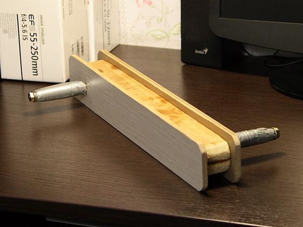 В принципе - это та же рыболовная моталка из доски, только с ручками.